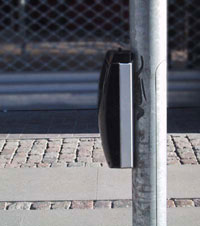 Figure 10-15. The tactile arrow on the APS in Denmark was on top of the device which was located on a pole near the crosswalk line. Most intersections were pretimed so no pushbutton was included on this device.
