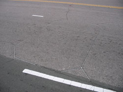 Figure 3-2. Photograph of vehicle detector loop in pavement
