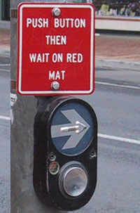 Figure 4-10. Detail of APS at midblock crossing in Australia. Sign reads