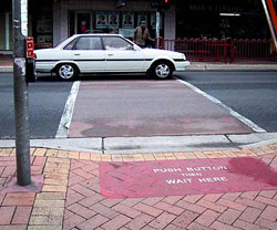 Figure 4-11. This midblock crossing has sensors in a specific area of the sidewalk. A red mat area is labeled