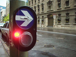 Figure 4-3. The tactile arrow above the pushbutton on this APS is superimposed on a larger visual arrow, but is not on the pushbutton as required by MUTCD