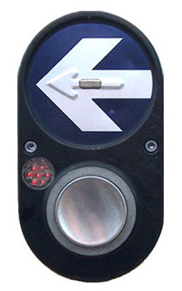 Figure 4-5. A red actuation light is near located just above and to the left of the pushbutton