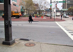 Figure 6-14. If pedestrians proceed directly to the curb from the pushbutton in this photo, they will be well outside the crosswalk area when beginning their crossing.