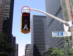 Figure 6-4. The mast arm is used in this installation in Toronto, Canada to position pedestrian signal head and speaker closer to the crosswalk.