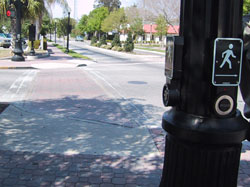 Figure 9-11. Two pushbuttons are located on fluted pole at this location with exclusive pedestrian phasing. Tactile arrow of each device points in the direction of travel on the crosswalk.
