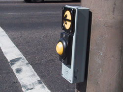 Figure 9-4. Vibrawalk pushbutton installed in Portland includes a locator tone. The arrow vibrates during the WALK interval and WALK indication is provided from pushbutton or speaker mounted on the pedhead.