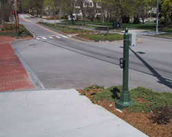 Figure 9-7. Panich APS on stub pole in Newton, Mass. Arrow oriented parallel to crosswalk.